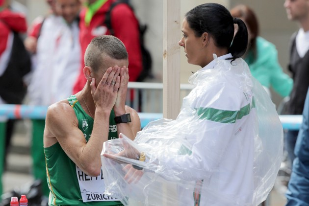 Rob Heffernan with Marian Heffernan after withdrawing from the