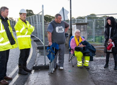 Kilkenny County Council Assistant Director of Services Simon Walton (L) and Director of Services John McCormack (2nd L) stand with the last remaining Kilkenny bridge protesters, (L-R) Donal Coyne, Kay Brennan, and Aisling Hurley
