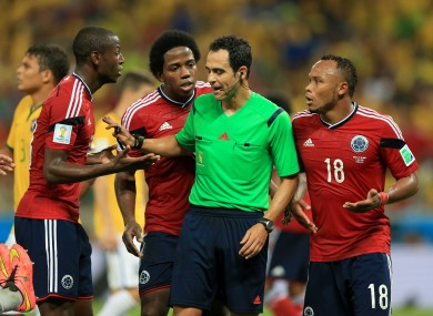 Colombia's Fredy Guarin (left) and Juan Camilo Zuniga (right) argue with the referee during the quarter final World Cup match against Brazil.