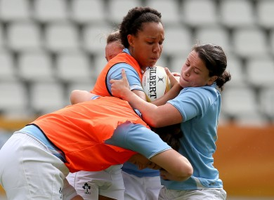 Sophie Spence takes contact from Jackie Shiels in yesterday's session.