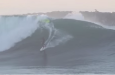 Hero surfer switches surfboards, MID-WAVE