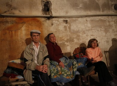 Locals sit in a basement used as a shelter after shelling in Donetsk, eastern Ukraine yesterday.