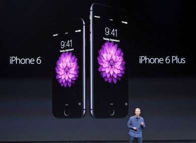 Tim Cook introduces the new iPhoneS in Cupertino.