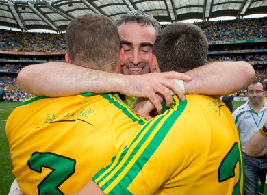 Eamon and Neil McGee celebrated with manager Jim McGuinness at the final whistle.