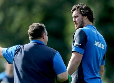 Leinster coach Matt O'Connor talks to Douglas at UCD this afternoon.