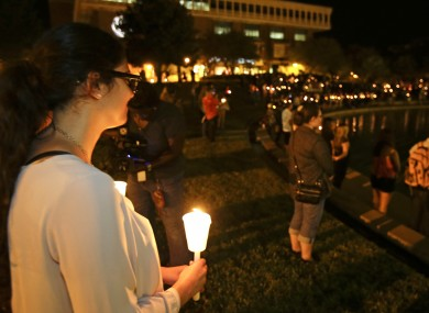 Students and supporters take part in a candle light vigil at the University of Central Florida.