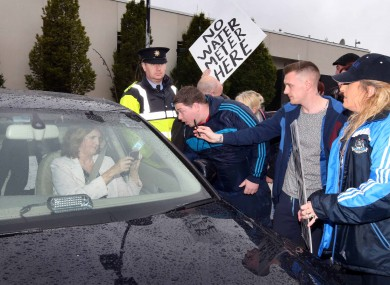 Joan Burton is pursued by water protesters at an event in Coolock earlier this month.