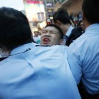 A student protester is injured in the scuffles.<span class=