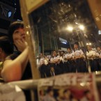 Protesters use mirrors to reflect images of the police back at themselves, at the pro-democracy protest site in the Mong Kok district of Hong Kong. Officials and student leaders held talks Tuesday to try to end pro-democracy protests that have gripped the southern Chinese city for more than three weeks, though chances of success are slim given the vast differences between the two sides. (AP Photo/Wally Santana)<span class=