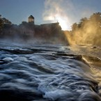 Steam rises from the Royal River as it flows past the Sparhawk Mill on a chilly autumn morning in Yarmouth, Maine.<span class=