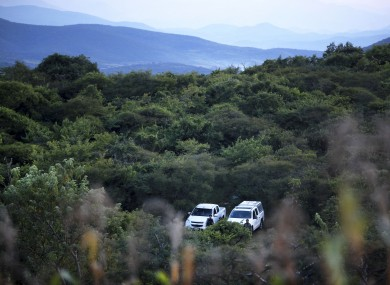 Mexican navy marines and officers guard the area where new clandestine mass graves were found.