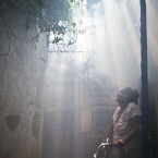 An elderly woman stands in a cloud of insecticide after a health ministry worker fumigated her house against mosquitoes that transmit dengue fever as well as chikungunya fever, in Managua, Nicaragua. (AP Photo/Esteban Felix)<span class=