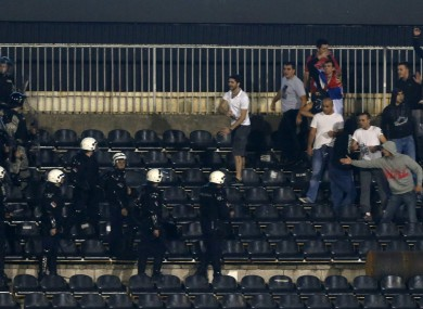 Serbian riot police officers clash with soccer fans