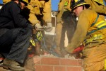 A woman got stuck in a chimney while breaking into the home of a guy she met online