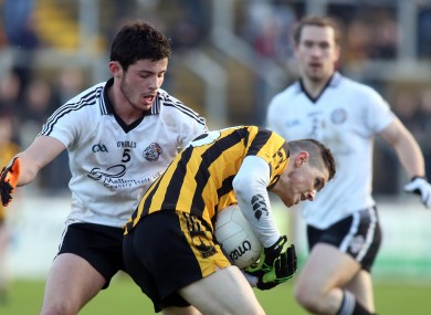 St. Eunan's Cillian Morrison and Omagh's Ciaran McLaughlin battle for possession.