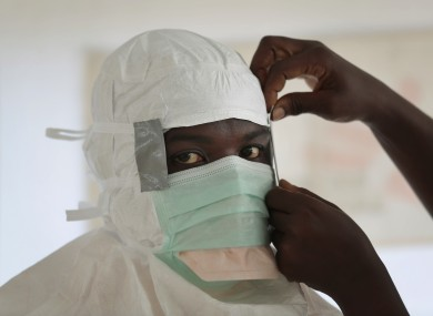 A MSF (Medecins Sans Frontieres) nurse gets prepared with Personal Protection Equipment in Liberia.