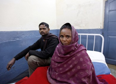 File photo. A patient recuperates on a hospital bed after undergoing a free sterilization procedure at the Mohan Lal Gautam District Women's Hospital in Aligarh, India.