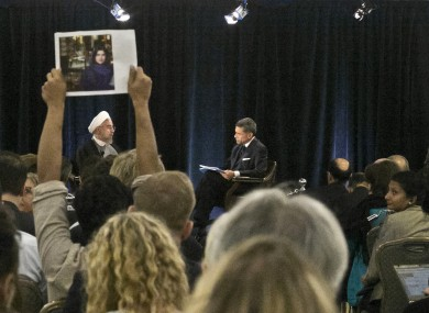 Protester holds up a picture of Ghoncheh Ghavami as Iran's President speaks in New York