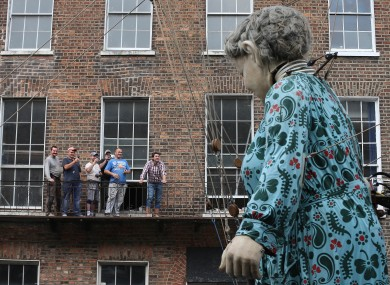 Crowds watch as performers from French arts group Royal de Luxe take to the streets of Limerick.