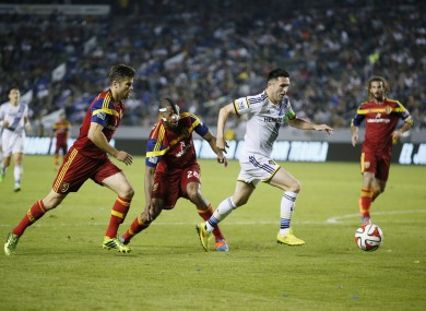 Los Angeles Galaxy's Robbie Keane, second right, takes the ball past Real Salt Lake's Chris Wingert, left.