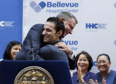 Dr. Craig Spencer is hugged by New York Mayor Bill de Blasio during a news conference.