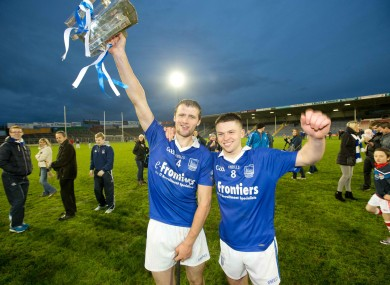 Pa Bourke lifts the trophy with Stephen Cahill.