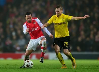 Arsenal's Santi Cazorla (left) and Borussia Dortmund's Lukasz Piszczek in action during the UEFA Champions League match at the Emirates Stadium.