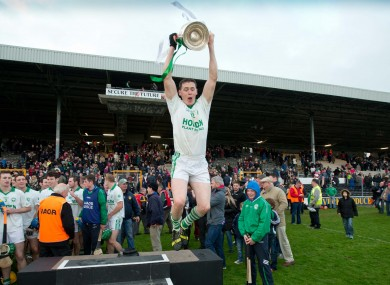 TJ Reid celebrates with the Kilkenny senior trophy.