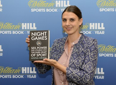 Anna Krien poses with a copy of her book