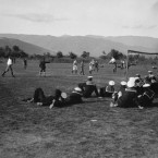 British Navy officers watch on as Warship Company play a football match in Stavros, Greece. (1916)<span class=
