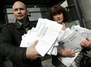 Socialist TD Paul Murphy returning unopened Irish Water registration packs to the utility.