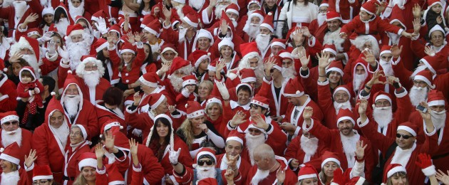 Around 250 people dressed in Santa Claus costumes pose for photographers before a parade in the streets of Vallauris, southeastern France