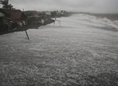 Strong waves threaten coastal houses as Typhoon Hagupit pounds Legazpi.