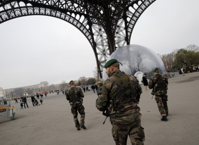 French soldiers patrol at the Eiffel Tower earlier this month.