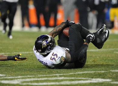 Terrell Suggs intercepts the ball with his knees on a crucial play last night.