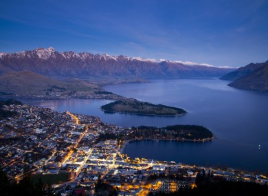Aerial view of Queenstown downtown at dusk, South Island, New Zealand.