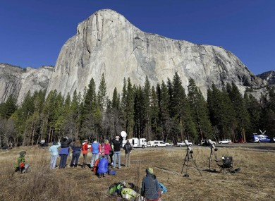 Spectators gaze at El Capitan for a glimpse of climbers Tommy Caldwell and Kevin Jorgeson.