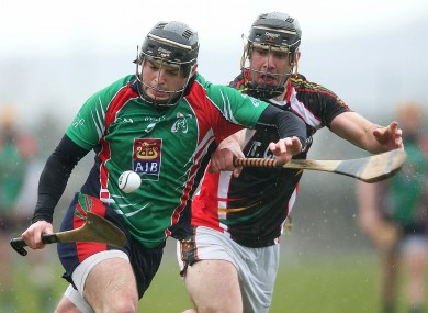 Alan Dempsey of Limerick gets away from James Gannon of IT Carlow