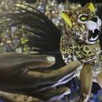 A performer from the Imperatriz Leopoldinense samba school parades on a float during carnival celebrations at the Sambadrome in Rio de Janeiro, Brazil. (AP Photo/Felipe Dana)<span class=