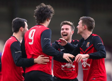 Calvin O'Callaghan celebrates scoring UCC's first goal.