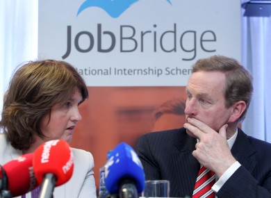 Joan Burton and Enda Kenny at the launch of a JobBridge report in 2013.