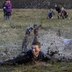 One of the players falls over during the Shrovetide football match in Alnwick, Northumberland.
