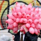 A Japanese man with balloons on his head waits to meet the Duke of Cambridge outside Ishinomaki local newspaper office in Ishinomaki, Japan.<span class=