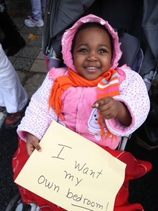Hannah Komdwe (2) at a direct provision protest in November.