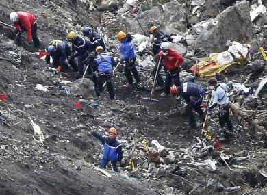 Rescue workers sift through the debris after the Germanwings disaster in the French Alps last week.