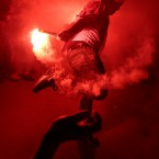 A young man dances with flares during a local wedding in Salam City, a suburb on the outskirts of Cairo. Since the 2011 uprising, the music of