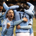 New York City FC's Ned Grabavoy, front left, celebrates with teammate Patrick Mullins (14) after Mullins scored the team's second goal against the New England Revolution in an MLS soccer game in New York. NYC FC won the game 2-0. (AP Photo/Peter Morgan)<span class=