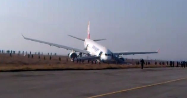 Plane carrying 224 passengers skids off runway, ends up on grass