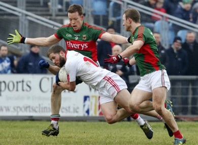 Colm Boyle and Donal Vaughan attempt to tackle Peter Hughes of Tyrone.