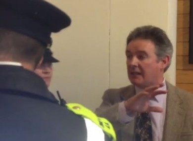 A demonstrator asks gardaí for entry to the in-camera proceedings.